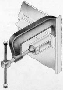 Fig. 28-Dog bracket clamped in place ready for installation.